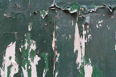 old wallpaper: Vintage grunge background. Old fence with torn posters