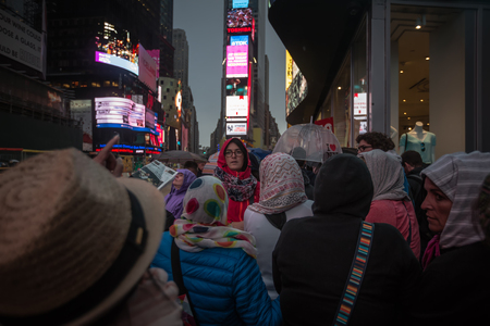 42nd: NEW YORK, USA - Apr 30, 2016: Crowd in Times Square in NYC at night. Brightly adorned with billboards and advertisements, Times Square is sometimes referred as Crossroads of the World