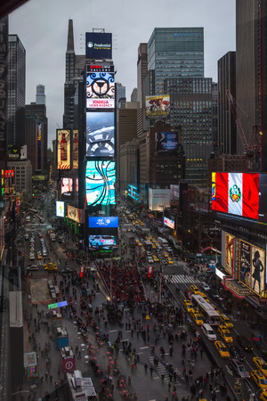 referred: NEW YORK, USA - Apr 30, 2016: Times Square in the eveningin. Brightly adorned with billboards and advertisements, Times Square is sometimes referred to as The Crossroads and The Heart of the World