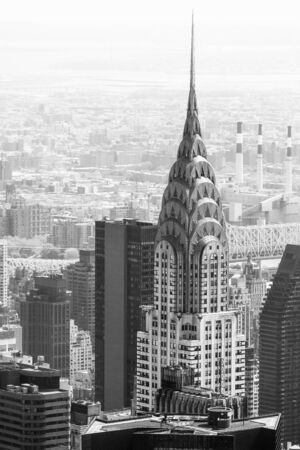 chrysler: NEW YORK, USA - Apr 30, 2016: Black and white image of Manhattan streets and roofs with Chrysler building. New York City Manhattan midtown birds eye view