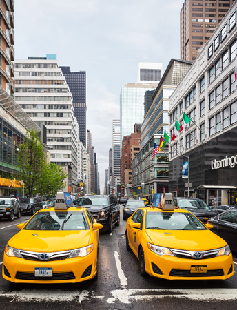 fifth avenue: NEW YORK, USA - May 1, 2016: Taxi on the streets of Manhattan. Manhattan is the most densely populated of the five boroughs of NYC