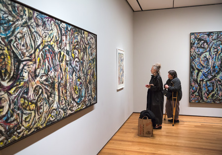 NEW YORK, USA - May 01, 2016: People inside Museum of Modern Art. MoMAs collection offers an overview of modern and contemporary art, architecture, design, drawing, painting, sculpture, photography Editorial
