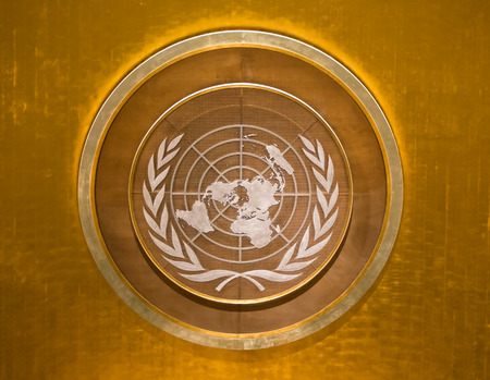 above 21: NEW YORK, USA - Sep 21, 2016: The emblem of the United Nations in the meeting room above the the podium at the UN Headquarters