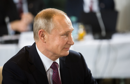 dictator: BERLIN, GERMANY - Oct 19, 2016: Russian President Vladimir Putin before the negotiations of leaders of states in Normandy format in Berlin Editorial