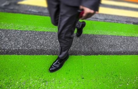 cross street: Zebra crossing. Man cross street at crosswalk in the city
