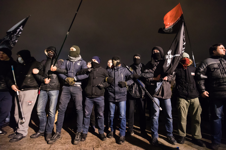 activists: KIEV, UKRAINE - Nov 21, 2016: Activists of nationalist groups and their supporters on Independence Square as they gather to mark the anniversary of the 2014 Ukrainian pro-European Union mass protests