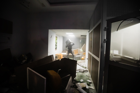 activists: KIEV, UKRAINE - Nov 21, 2016: Participants attack a branch of Sberbank during a rally held by activists of nationalist groups who mark anniversary of 2014 Ukrainian pro-European Union mass protests Editorial