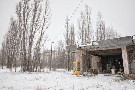 pripyat: CHERNOBYL REG, UKRAINE - Nov 29, 2016: Chernobyl Exclusion Zone. Lost city. Ruins of buildings in the abandoned city of Pripyat. Winter in zone of exclusion. Zone of high radioactivity