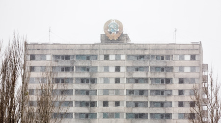 reg: CHERNOBYL REG, UKRAINE - Nov 29, 2016: Chernobyl Exclusion Zone. Snowfall in lost city. Ruins of buildings in the abandoned city of Pripyat. Winter in zone of exclusion. Zone of high radioactivity