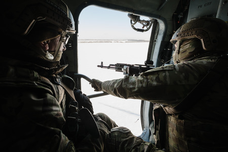 donetsk: DONETSK REGION, UKRAINE - Dec 05, 2016: Ukrainian army helicopter during a combat mission in the area of the antiterrorist operation in the Donetsk region Editorial