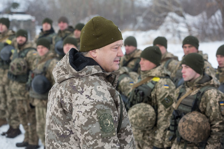 DONETSK REGION, UKRAINE - Dec 05, 2016: President of Ukraine Petro Poroshenko inspected stronghold on frontline near Horlivka in Donetsk region. Head of State had a conversation with the military