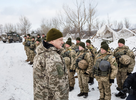 frontline: DONETSK REGION, UKRAINE - Dec 05, 2016: President of Ukraine Petro Poroshenko inspected stronghold on frontline near Horlivka in Donetsk region. Head of State had a conversation with the military
