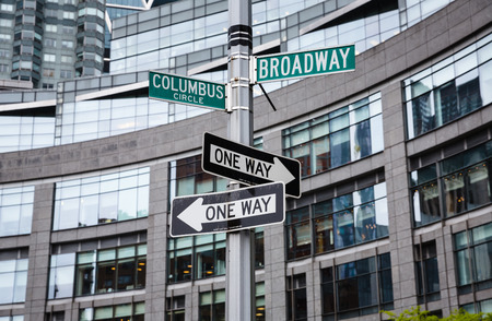 broadway tower: NEW YORK, USA - May 01, 2016: Street signs for Broadway and Columbus Circle, Manhattan, NYC Editorial