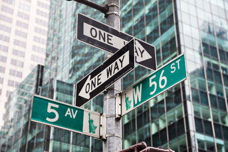 fifth avenue: NEW YORK, USA - May 01, 2016: Street signs for Fifth avenue and W 56 st crossroad in New York City, Manhattan, USA