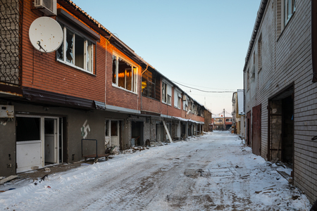 DONETSK REGION, UKRAINE - Dec 18, 2016: Destroyed houses and ruins, mechanisms, chaos and deserted village due to the war in eastern Ukraine