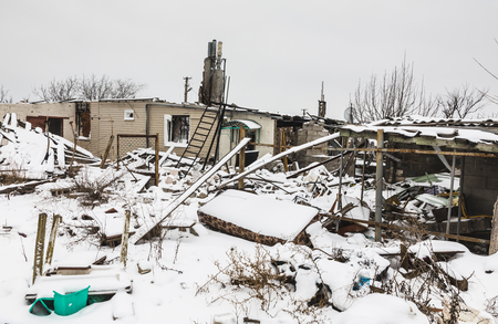 DONETSK REGION, UKRAINE - Dec 19, 2016: Destroyed houses and ruins, mechanisms, chaos and deserted village due to the war in eastern Ukraine