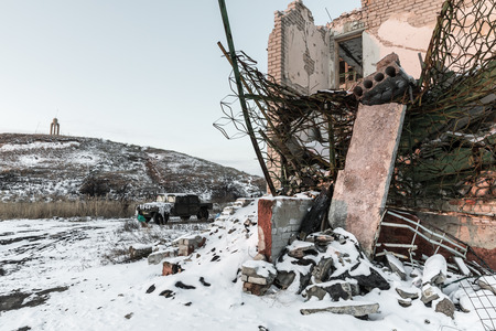 chaos: DONETSK REGION, UKRAINE - Dec 18, 2016: Destroyed houses and ruins, mechanisms, chaos and deserted village due to the war in eastern Ukraine