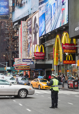NEW YORK, USA - May 03, 2016: Manhattan street scene. Police regulates the movement of vehicles in the area of Times Square in New York City Editorial