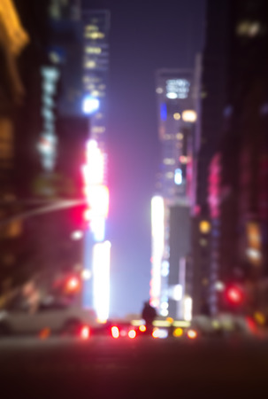 dark city: Abstract blurred city background. Large city street lights at night. Lights and shadows of New York City Stock Photo
