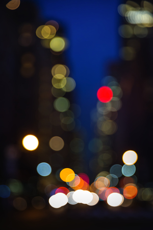 Abstract blurred city background. Large city street lights at night. Lights and shadows of New York City Stock Photo