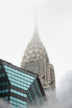 piped: NEW YORK, USA - May 03, 2016: Empire State Building. Manhattan street scene. Cloud of vapor from the subway on the streets of Manhattan in NYC. Typical view of Manhattan Editorial