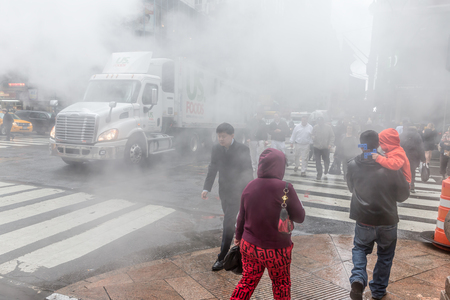 NEW YORK, USA - May 03, 2016: Manhattan street scene. Cloud of vapor from the subway on the streets of Manhattan in NYC. Typical view of Manhattan Editorial