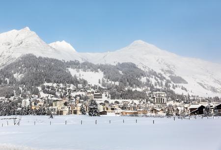 Winter view of Davos, famous Swiss skiing resort Фото со стока