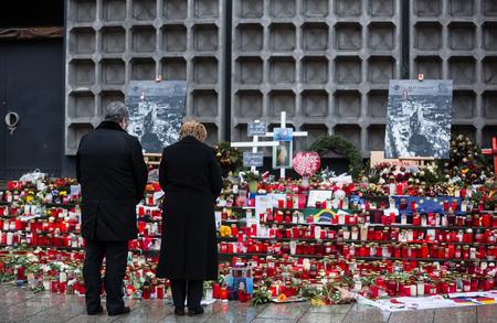 BERLIN, GERMANY - Jan 30, 2017: President of Ukraine Petro Poroshenko and German Chancellor Angela Merkel visited the place of tragedy, which occurred in the center of western Berlin December 19, 2016 Editorial