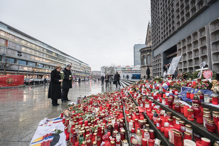 chancellor: BERLIN, GERMANY - Jan 30, 2017: President of Ukraine Petro Poroshenko and German Chancellor Angela Merkel visited the place of tragedy, which occurred in the center of western Berlin December 19, 2016 Editorial