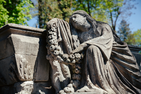 Old statue on grave in the Lychakivskyj cemetery of Lviv, Ukraine