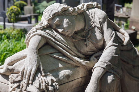 LVIV, UKRAINE - Apr 27, 2016: Old statue on grave in the Lychakivskyj cemetery of Lviv, Ukraine. Officially State History and Culture Museum-Preserve - Lychakiv Cemetery