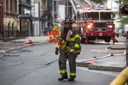 manhattans: NEW YORK, USA - May 02, 2016: Firefighters of New York City after the fire suppression of Manhattans Serbian Cathedral of Saint Sava at 25th and Broadway