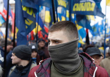 maidan: KIEV, UKRAINE - Feb 22, 2017: Activists of nationalist groups during the March of National Dignity to honor protesters who were killed during pro-European Maidan demonstrations in 2013-14