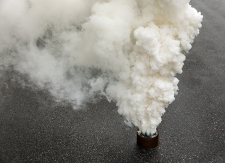 Fuming smoke bomb on the road during the protest action
