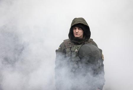rada: KIEV, UKRAINE - Feb 22, 2017: Soldiers of the National Guard of Ukraine maintain order near the Verkhovna Rada of Ukraine during the March of National Dignity