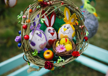 UZHGOROD, UKRAINE - Apr 08, 2017: Folk art and festival of Easter Eggs. Easter holiday. Easter eggs in the form of rabbits in the nest Editorial