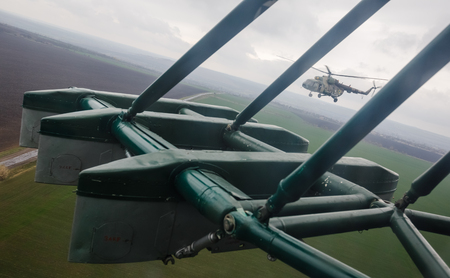 reg: LUGANSK REG, UKRAINE - Apr 12, 2017: Military helicopters on combat duty. Weaponry and military equipment of the armed forces of Ukraine