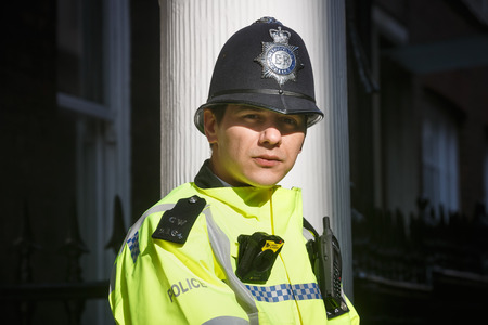 LONDON, UK - Apr 19, 2017: Metropolitan police officer on duty at 10 St James's Square The Royal Institute of International AffairsChatham House