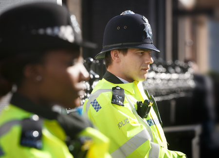 LONDON, UK - Apr 19, 2017: Metropolitan police officers on duty at 10 St Jamess Square The Royal Institute of International Affairs Chatham House