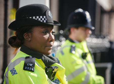 LONDON, UK - Apr 19, 2017: Metropolitan policewoman on duty at 10 St James's Square The Royal Institute of International Affairs