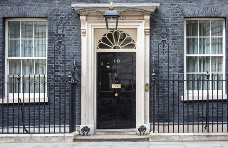 LONDON, UK - Apr 19, 2017: Entrance door of 10 Downing Street in London official residence of First Lord of the Treasury, headquarters of Her Majestys Government and office of Prime Minister