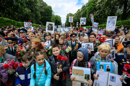 world war ii: KIEV, UKRAINE - May 09, 2017: The Immortal Regiment march devoted to the 72nd anniversary of the Soviet Union victory over Nazi Germany in World War II took place in Kiev