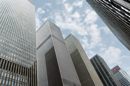 NEW YORK, USA - May 1, 2016: Modern architecture of Manhattan. Glass and concrete of Manhattan skyscrapers facades. Manhattan is the most densely populated of the five boroughs of New York City