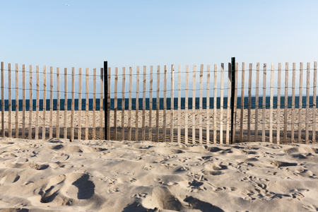 Wooden fence on Brighton Beach.  Brighton Beach is an oceanside neighborhood in the southern portion of the New York City borough of Brooklyn