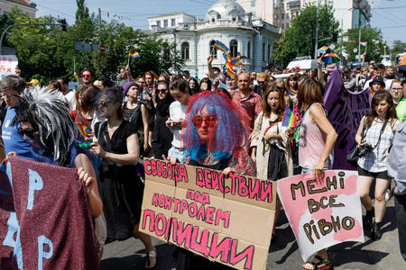 KIEV, UKRAINE - June 18, 2017: Pride Parade In Kiev. Ukrainian gay rights activists take part in a march in Kiev. Text - Freedom of action under police control