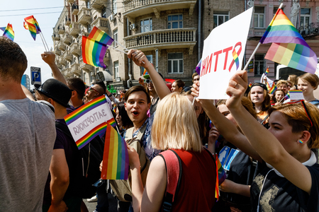 marched: KIEV, UKRAINE - June 18, 2017: Pride Parade In Kiev. Ukrainian gay rights activists take part in a march. Thousands of people marched in support of LGBT rights and equality in Ukraine