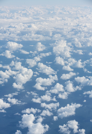 Sky with clouds, a view from an aeroplane above the clouds