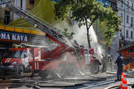 fireman: KIEV, UKRAINE - Jun 20, 2017: Ukrainian firefighters try to extinguish a fire in a three-story house on Khreshatyk street, the main street in Kiev. Firefighters in action