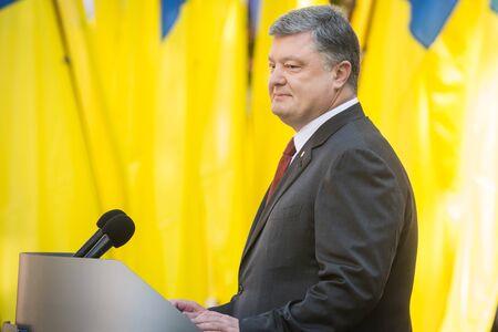 KIEV, UKRAINE - Jun 28, 2017: President of Ukraine Petro Poroshenko speaking against Ukrainian flags on the occasion of Constitution Day of Ukraine