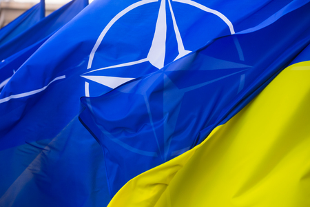 KIEV, UKRAINE - Jul 10, 2017: The national flags of Ukraine and NATO during visit of NATO Secretary General Jens Stoltenberg to Ukraine